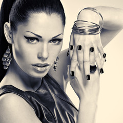 Woman with black nails and with stylish bijouterie