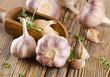Leinwanddruck Bild - garlic  on  a wooden board