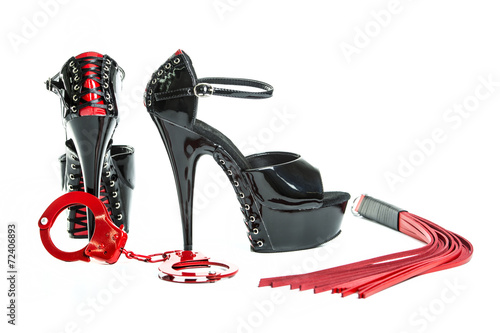 Fetish stuff: hand cuff, whip and extreme high heels shoes - 72406893