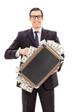Delighted businessman holding a briefcase full of money
