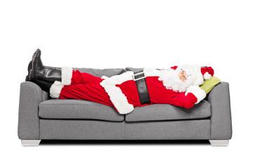 Santa Claus sleeping on a modern sofa