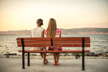 Girls sitting on the bench
