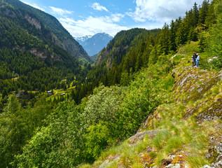 Family in summer Alps mountain (Switzerland).