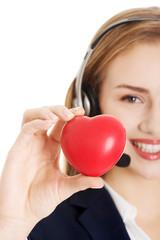 Call center woman holding heart