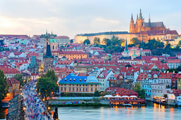 Cityscape of Prague with Castle and Charles Bridge at sunset, Cz