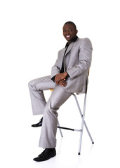 Black businessman sitting on a chair