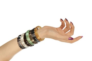 Beautiful woman hand with gemstone bracelet