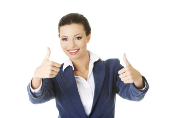 Happy businesswoman thumbs up