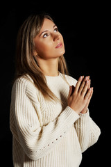 Caucasian woman praying