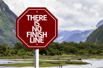 There is No Finish Line written on red road sign