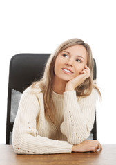 Young woman sitting at work