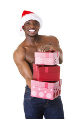 Black man holding christmas gifts