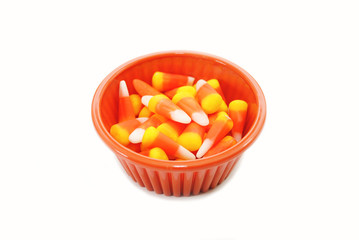 Candy Corn in an Orange Bowl Over White