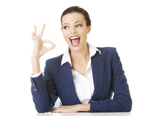 Businesswoman gesturing ok sign