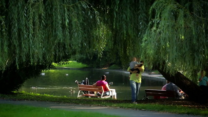 People relaxing near pond