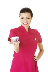 Visage artist holding cream container