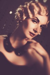 Elegant blond retro woman with beautiful hairdo