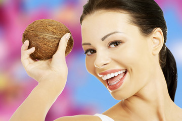 Beautiful woman holding coconut