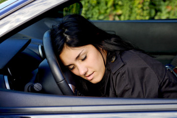 Woman falling asleep on wheel in car drunk