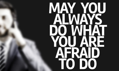 Man with the text May You Always Do What You Are Afraid To Do