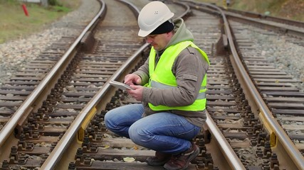 Railway engineer looking for information in tablet PC