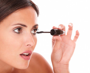 Hispanic female pampering her eyelash with mascara