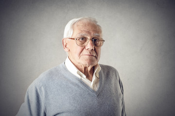 Elderly man posing for a picture