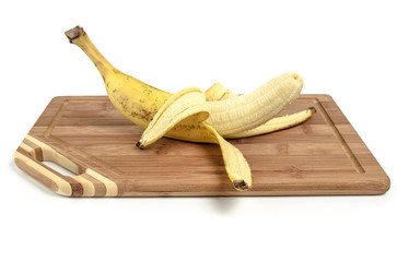 Banana on cutting board