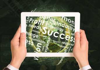 Man hands using tablet pc. Earth and business words on touch