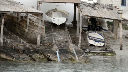 Boats in a small old traditional pier in Formentera, Balearic Is
