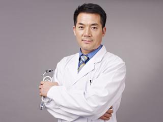 studio portrait of an asian doctor