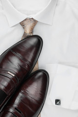 Classic men's shoes, tie on a white shirt