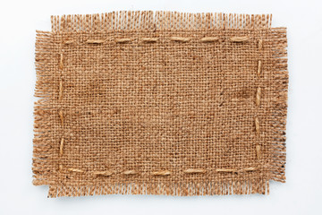 Frame of burlap, lies on a background of burlap  with place for