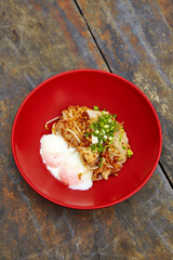 close up thai spicy pork noodle in red cup