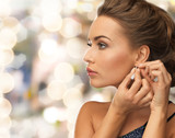 close up of woman wearing earrings