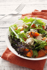Salad with pumkin, chicken  and lettuce