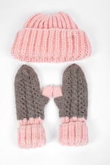 Cold winter clothing. knitted winter gloves and hat