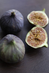 Fresh ripe figs on the wooden table