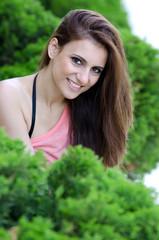 Greek brunette woman concealing herself