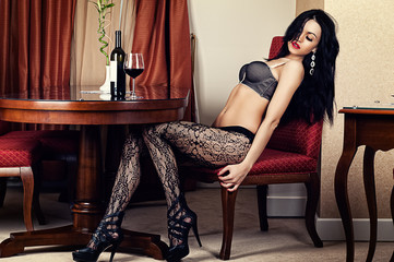 sexy woman sitting in a chair in lingerie
