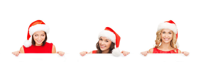 women in santa helper hat with blank white board