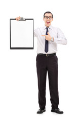 Happy business guy pointing on a clipboard