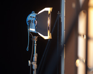 Metal clip on a tripod for lighting