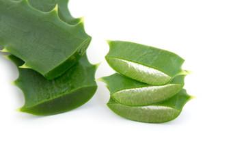 aloe vera leaf and slices isolated on white background