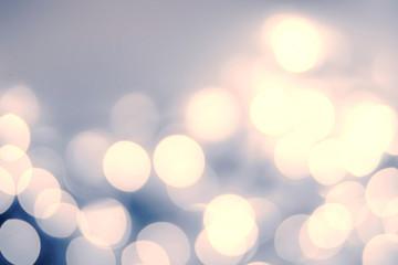 Vintage Christmas background with bokeh lights. Defocused Bokeh