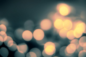 Dark Defocused Bokeh twinkling lights Vintage background. Christ