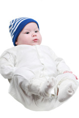 A cute newborn little baby girl with blue eyes isolated