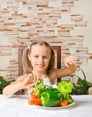Little girl eat vegetables