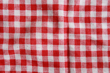 Texture of a red and white checkered picnic blanket