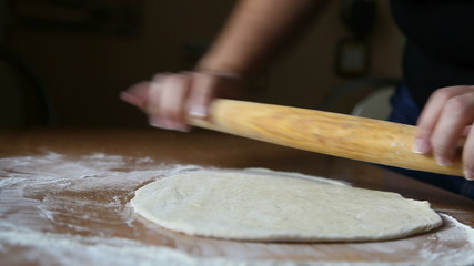 Woman rocking rocking dough